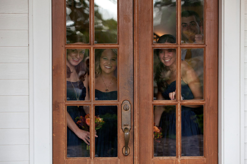 Bridesmaids Behind Wooden Door