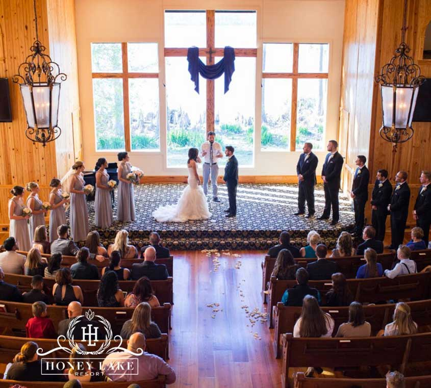 Wedding ceremony in a rustic church overlooking a lake at Honey Lake Resort in Florida