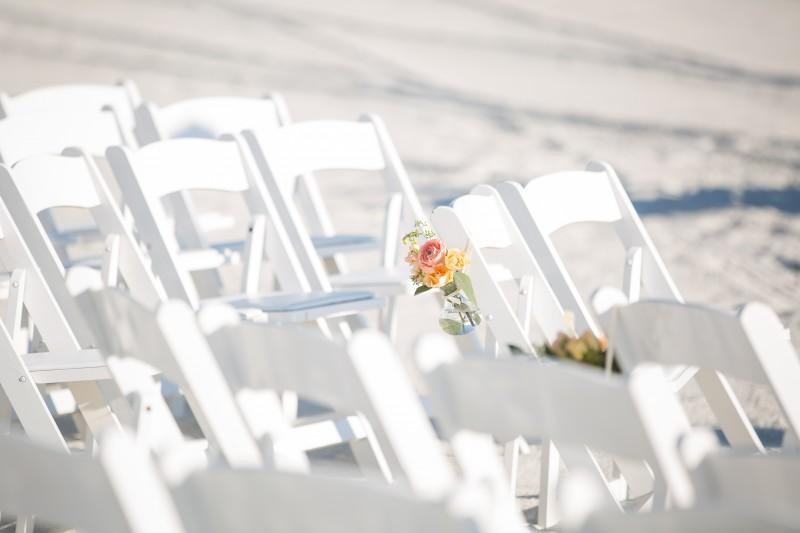 Pristine beach ceremony chairs