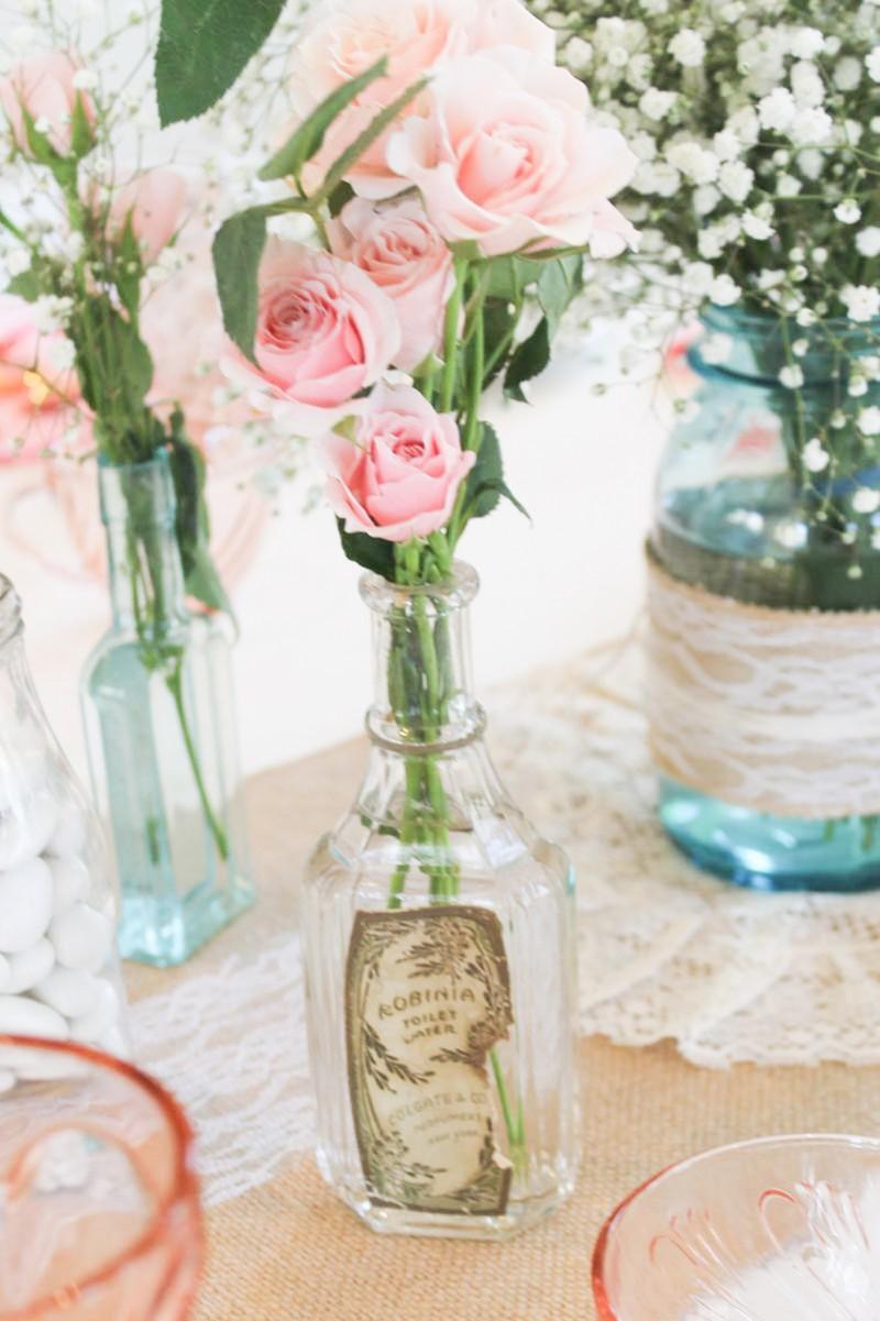 Southern Vintage Baby Shower-table antique bottles roses