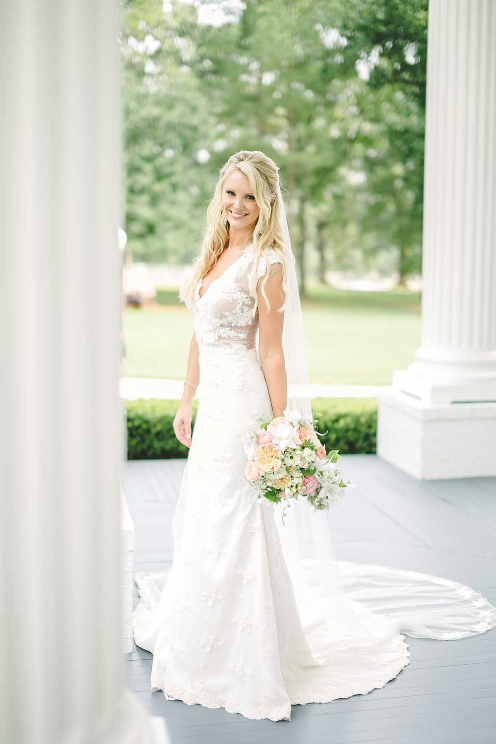 Southern Bride In Lace Dress Carrying Pastel Fl Bouquet