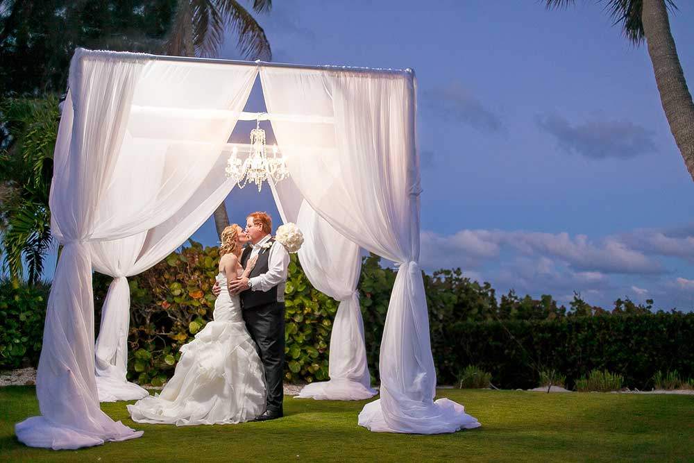 Swagged-Ceremony-Arch-with-Chandelier-at-Casa-Ybel-Resort