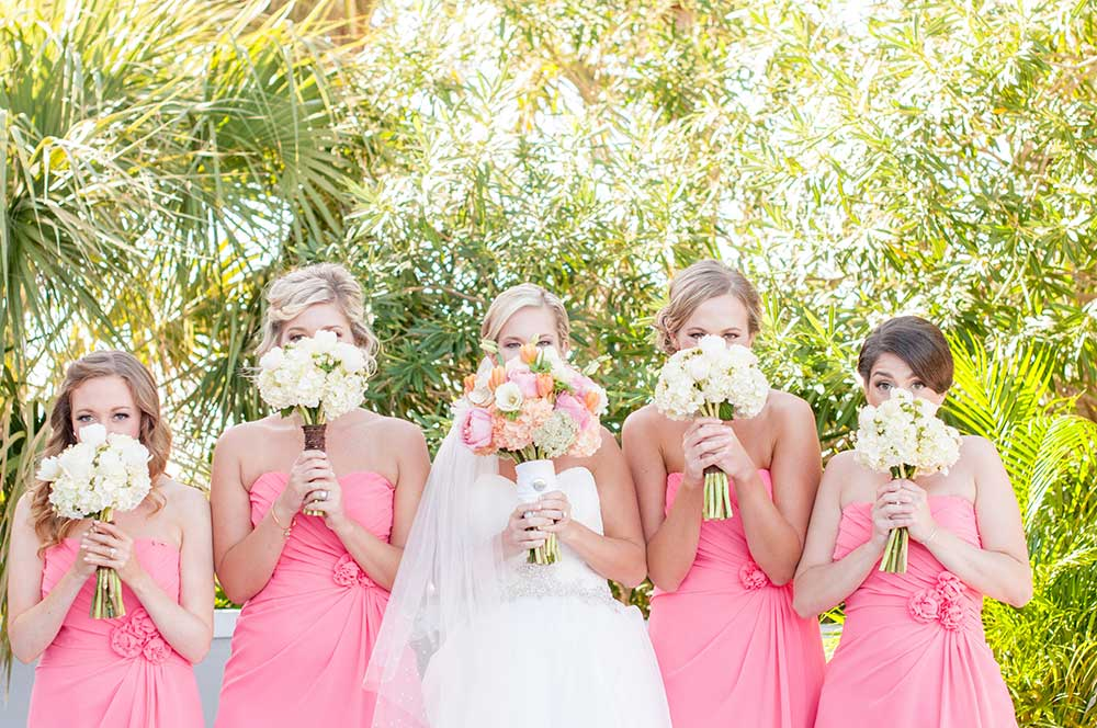 Bride-and-bridesmaid-in-short-pink-dresses-and-white-bouquets