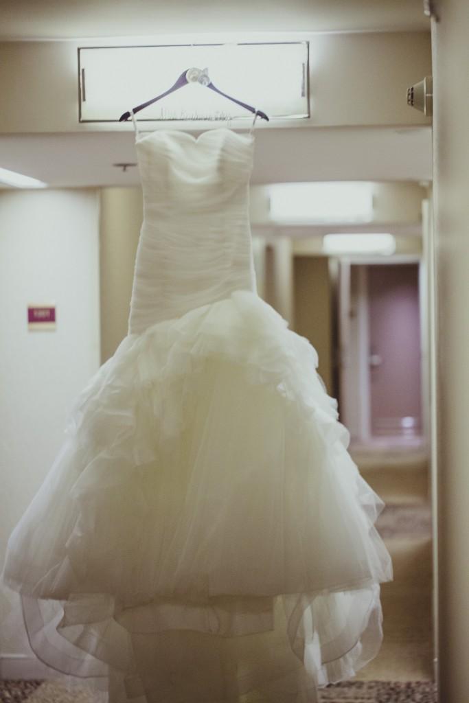 White mermaid style ruffled wedding dress