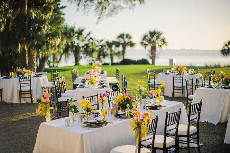 Black and White Reception Set Up with Colorful Flower Arrangements