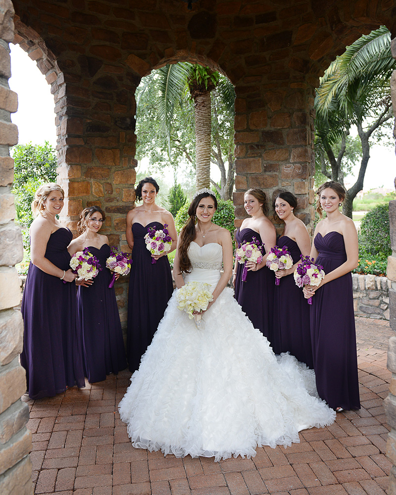 Bridal Party under Stone Archway
