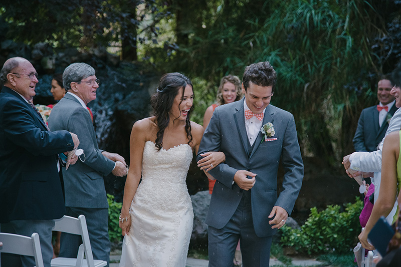 Bride and Groom Under Celebratory Lavender Toss
