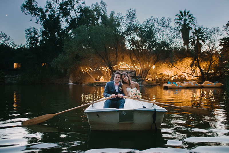 Bride and Groom in Paddleboat on Lake