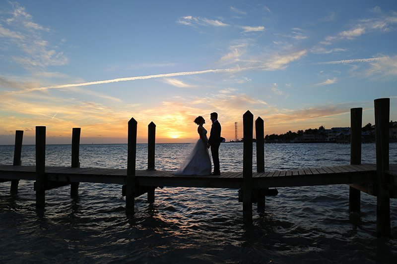 Bride and Groom on Pier at Sunset