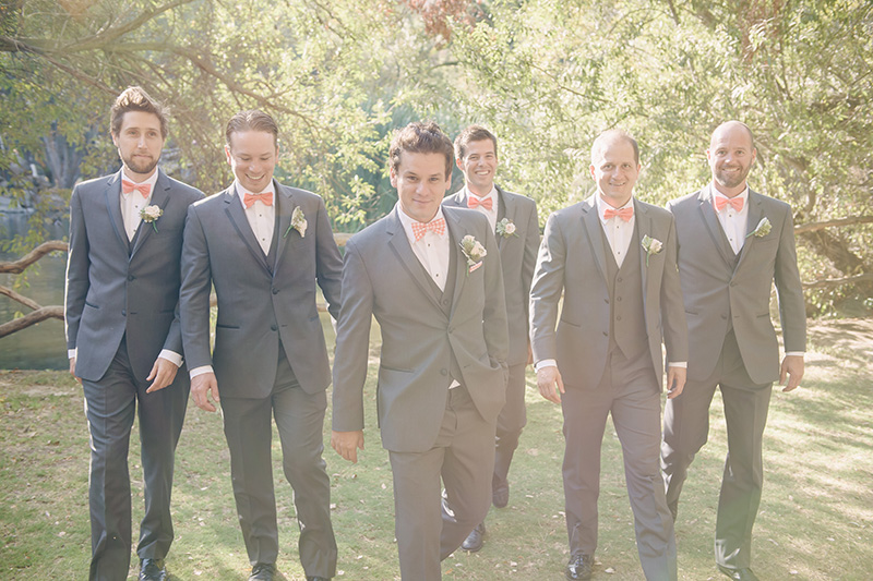 Groom and Groomsmen in Gray Suits and Peach Accessories