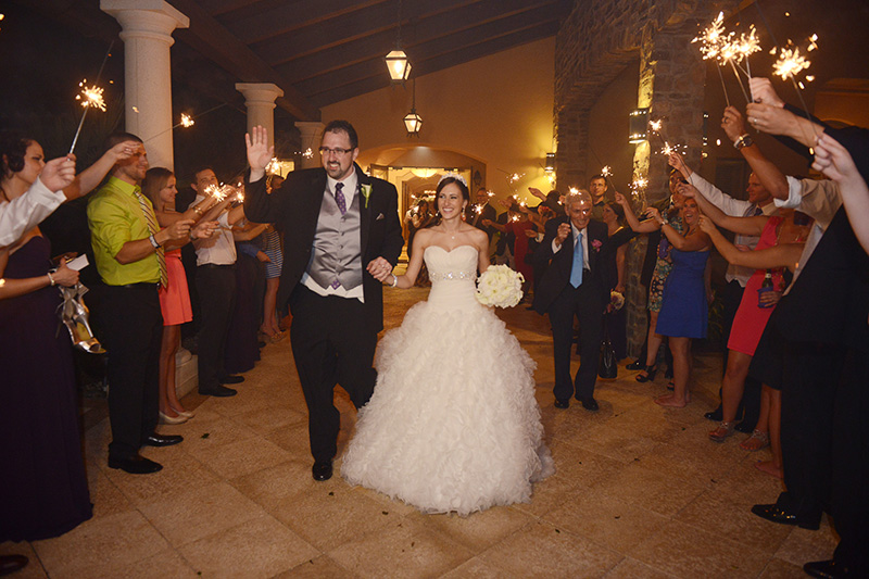 Newlyweds Leaving Rception with Sparkling Exit