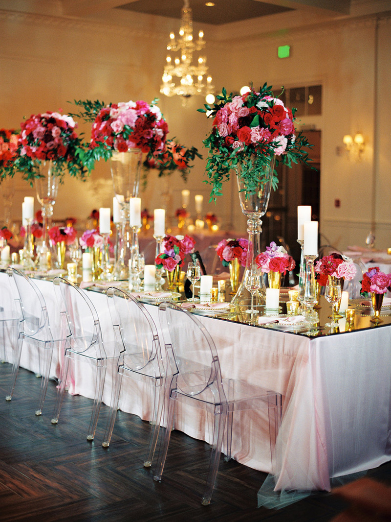 Pink and Gold Reception Setting with Ghost Chairs