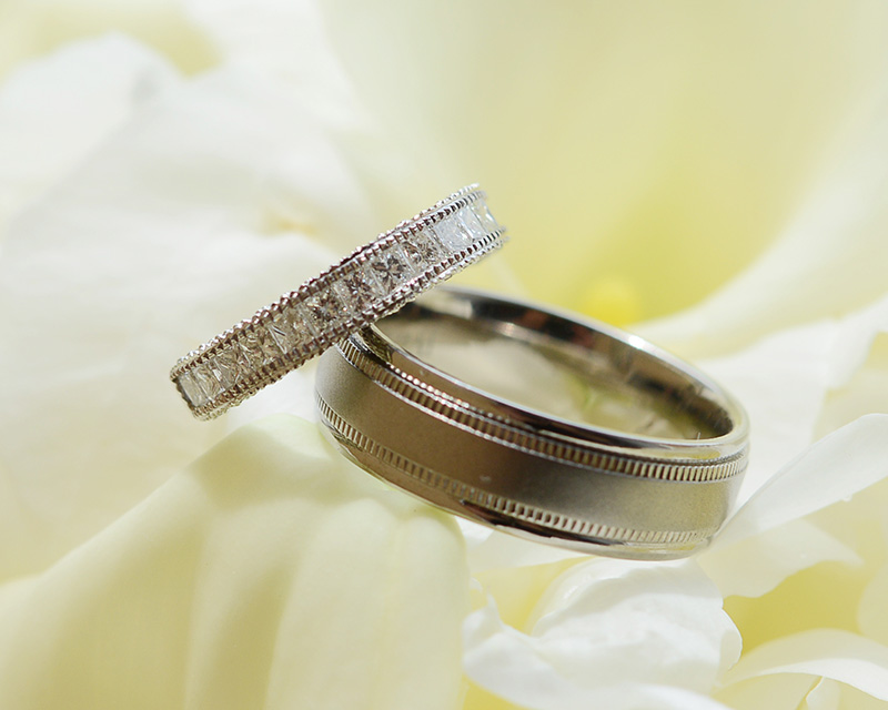 Silver Wedding Rings on White Flower Petals