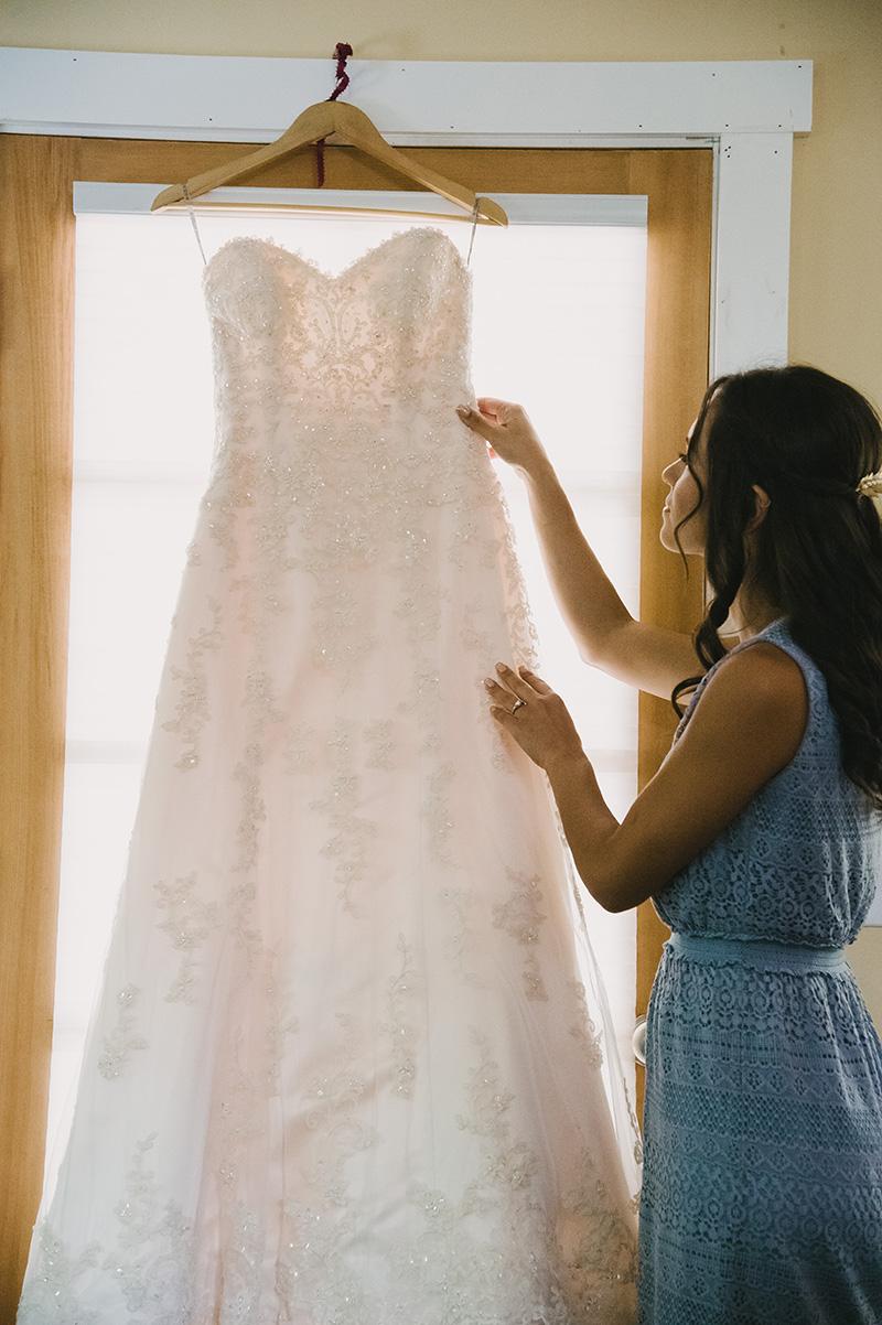 Strapless Beaded Maggie Sottero Wedding Dress Hanging Before Wedding