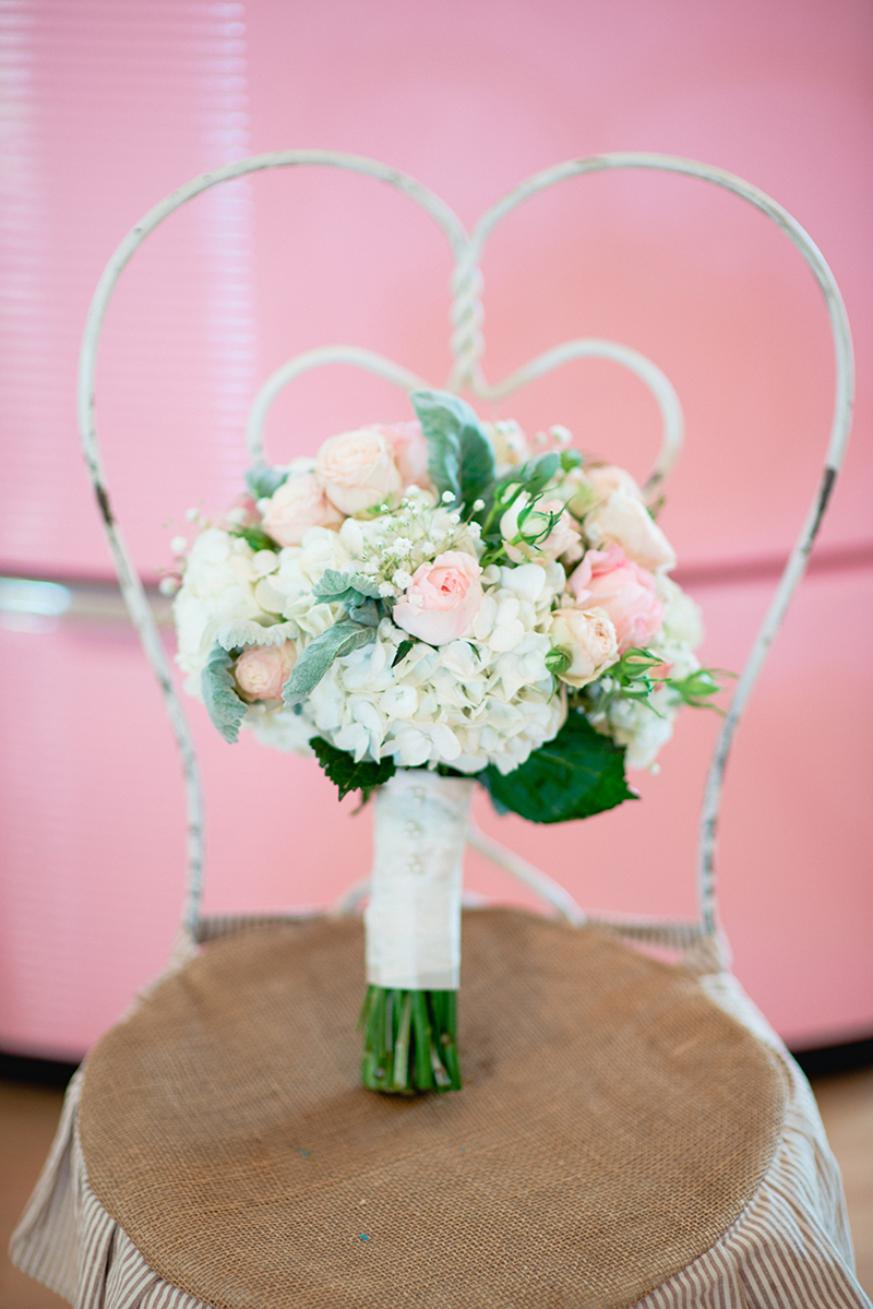 bouquet of pink and blush roses white hydrangeas and baby's breath