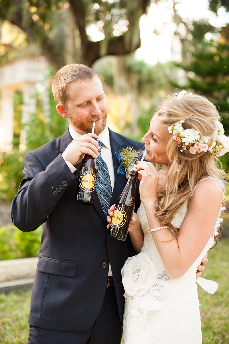 Bride and Groom Drinking Classic Soda Bottles and Whimsical Striped Straws