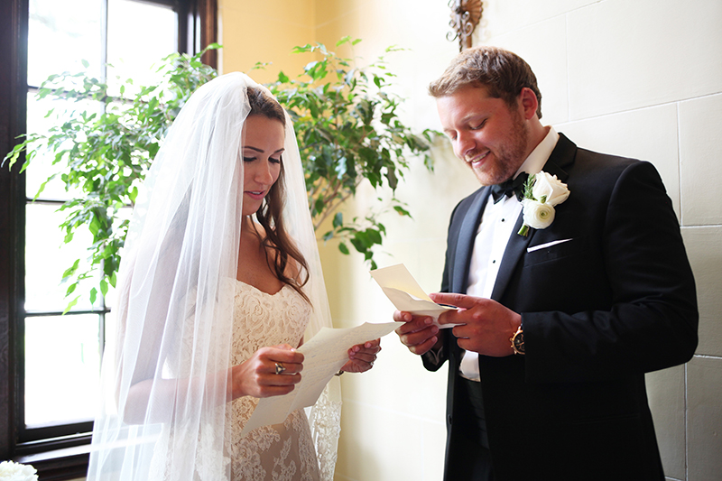 Bride and Groom Reading Letters Together During First Look