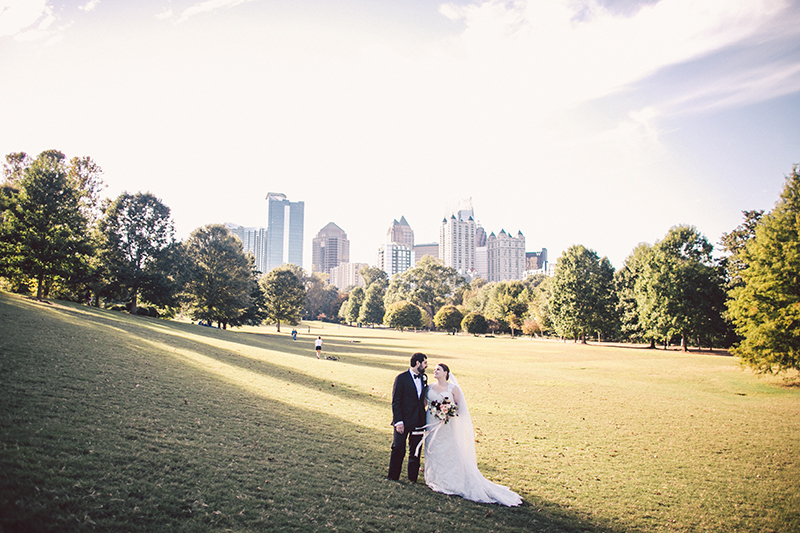Bride and Groom in Piedmont Park with Atlanta Skyline