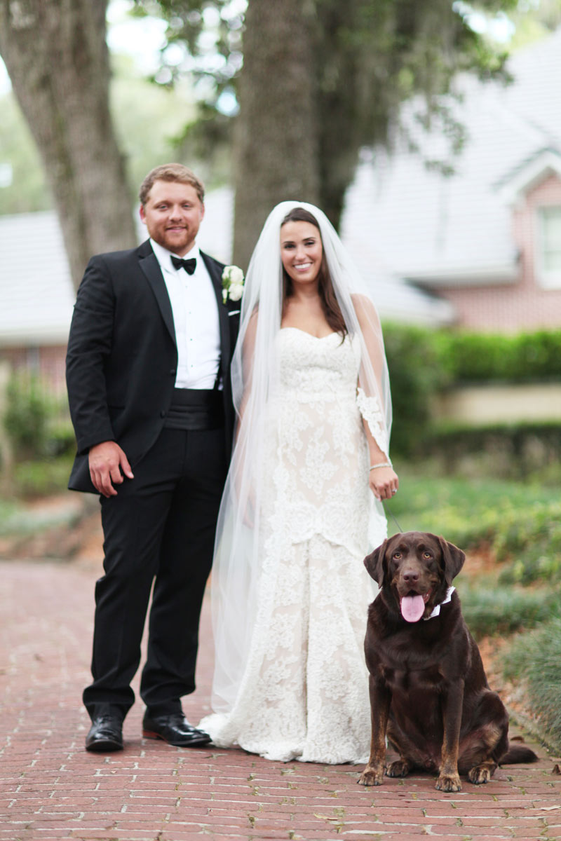 Bride-and-Groom-with-Their-Dog-on-Their-Wedding-Day