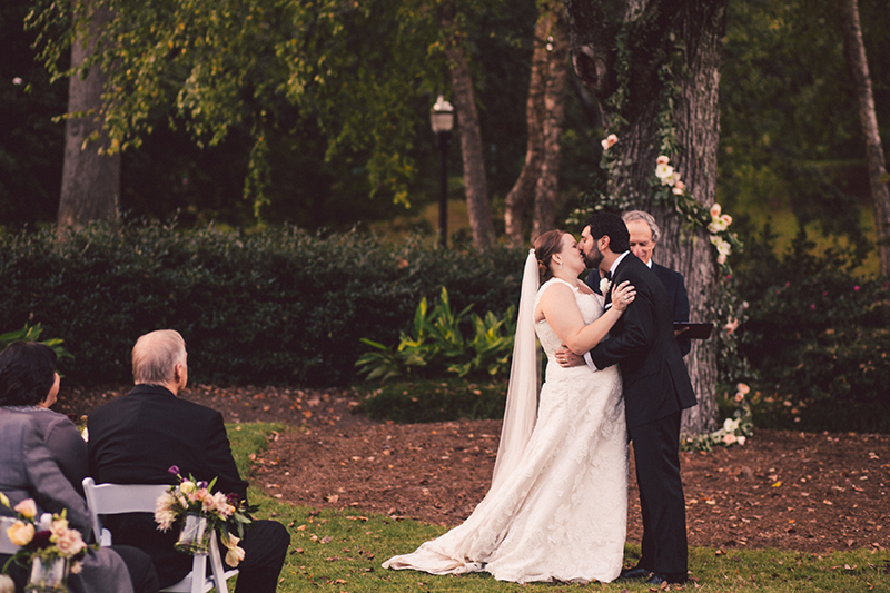 Bride and Groom's First Kiss in Outdoor Ceremony at Piedmont Park