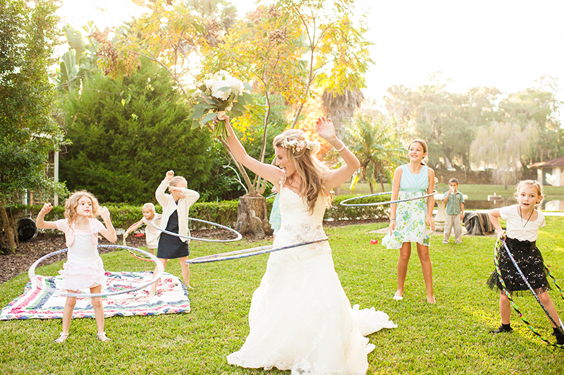 Bride and Kids Hula Hooping at Wedding Reception