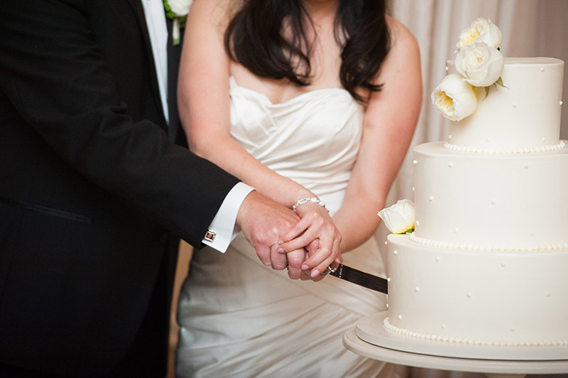Bride and groom cutting ivory floral circle cake