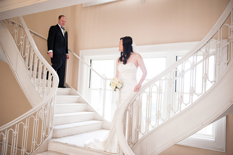 Bride and groom first look on stairs