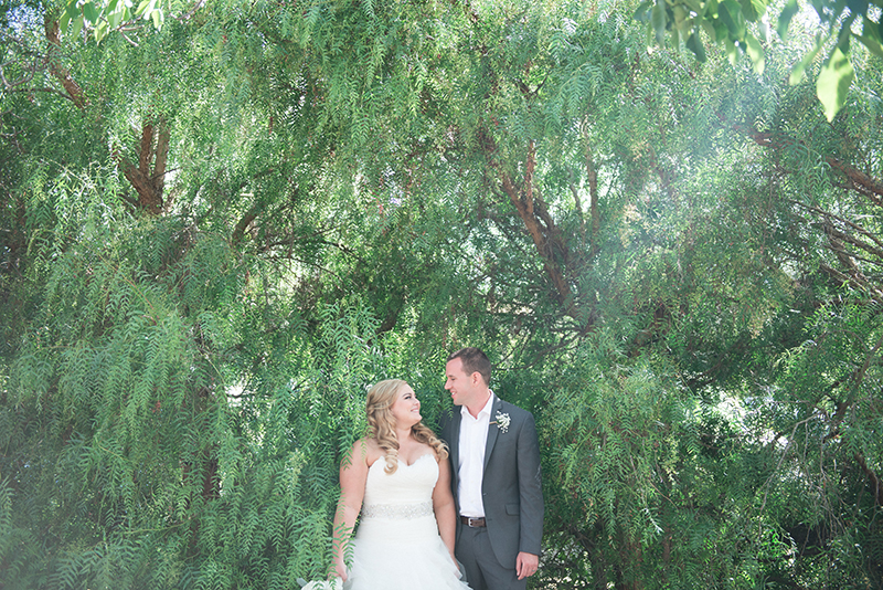 Bride and groom greenery outsdoor shot