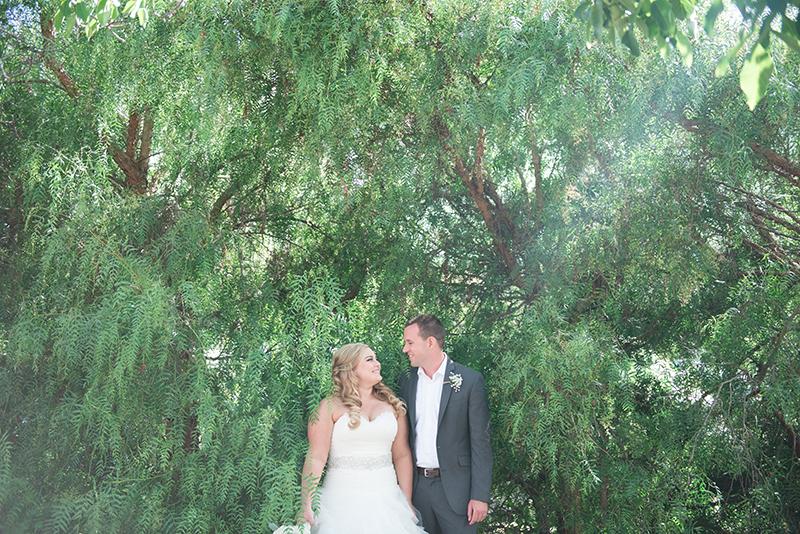 Bride and groom greenery outsdoor shot