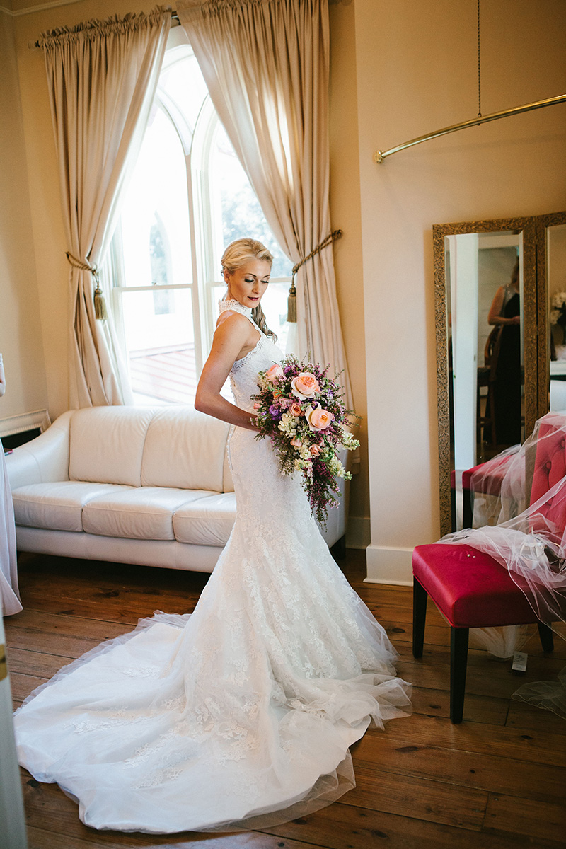 Bride in Lace Wedding Dress with Lush Fall Bouquet