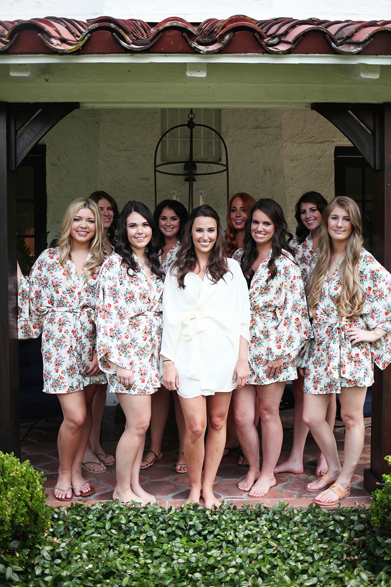 Bridesmaids and Bride in Matching Silk Robes Getting Ready