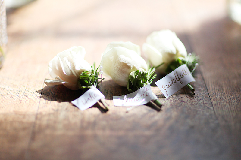 Classic Rose Boutonnieres with Calligraphed Labels