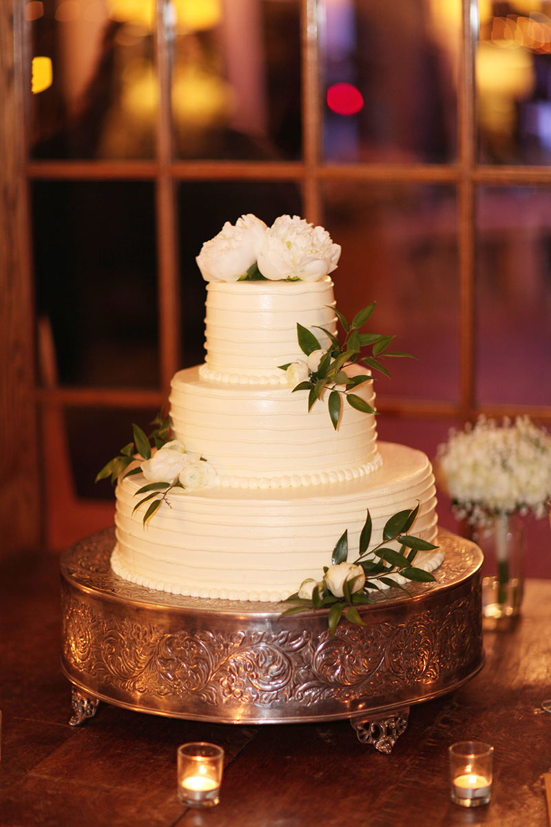 Clean White Wedding Cake with Peony Accents