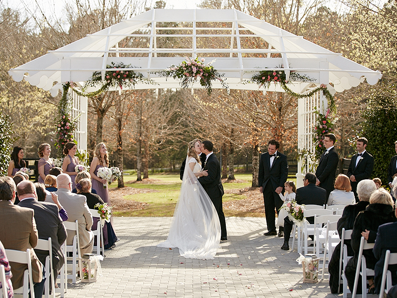 First Kiss During Outdoor Ceremony at Foxhall Resort and Sporting Club