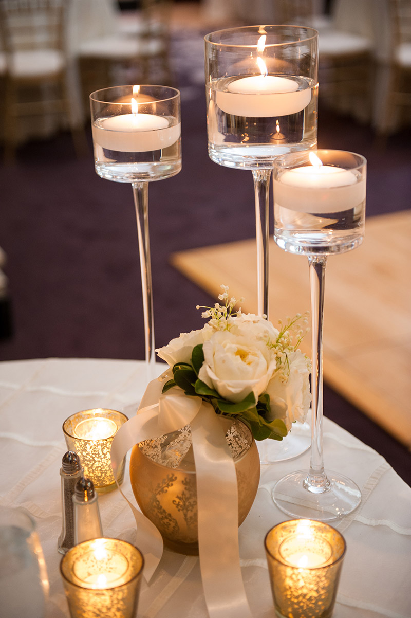 Floating candles on ivory table cover