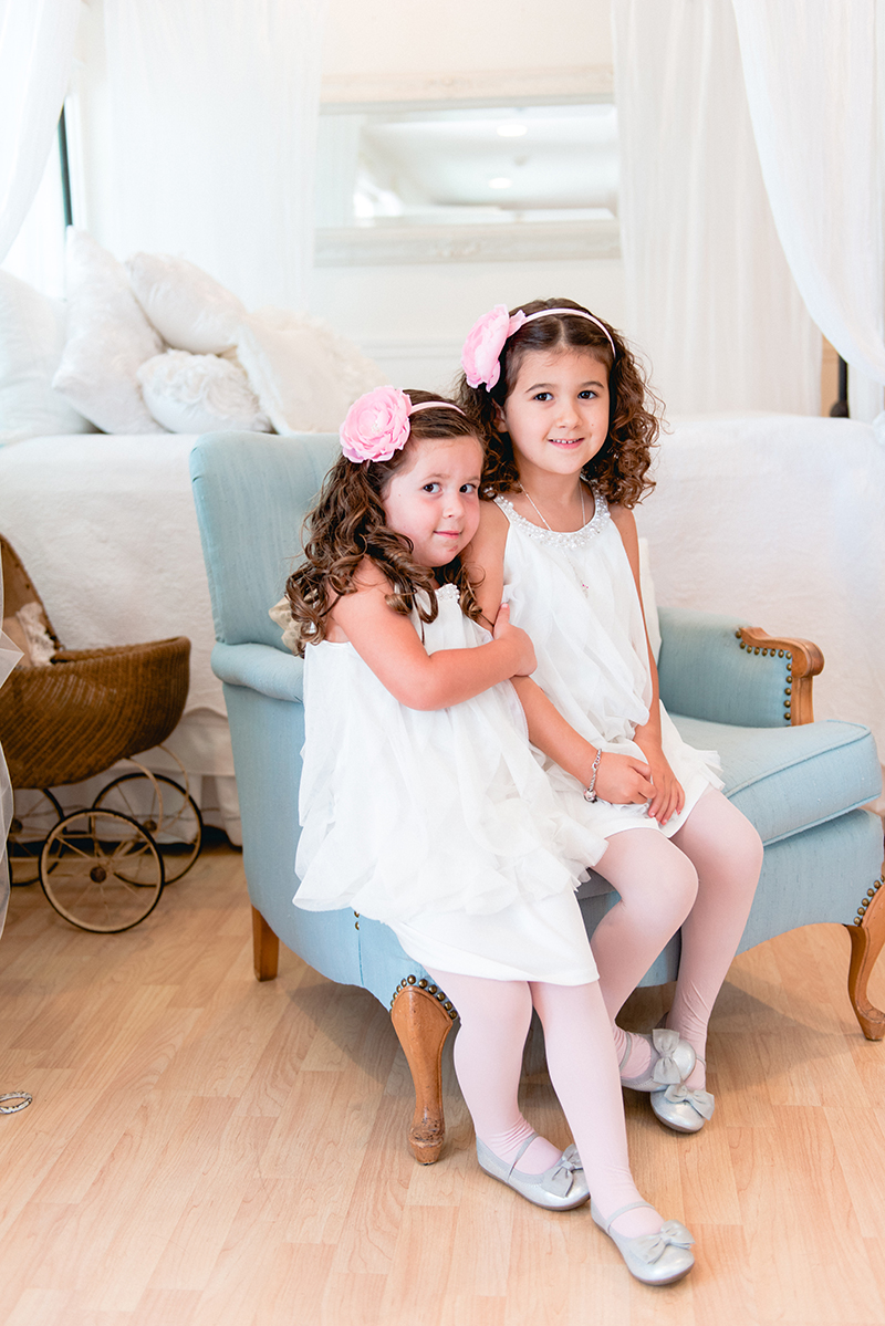 flower girls in short white dresses and pink floral headbands