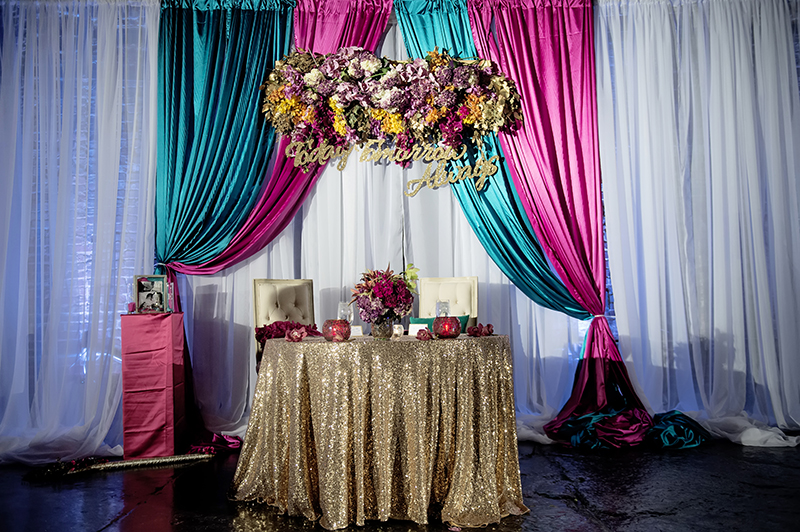 Gold Sequin Sweetheart Table with Hanging Floral Arrangement