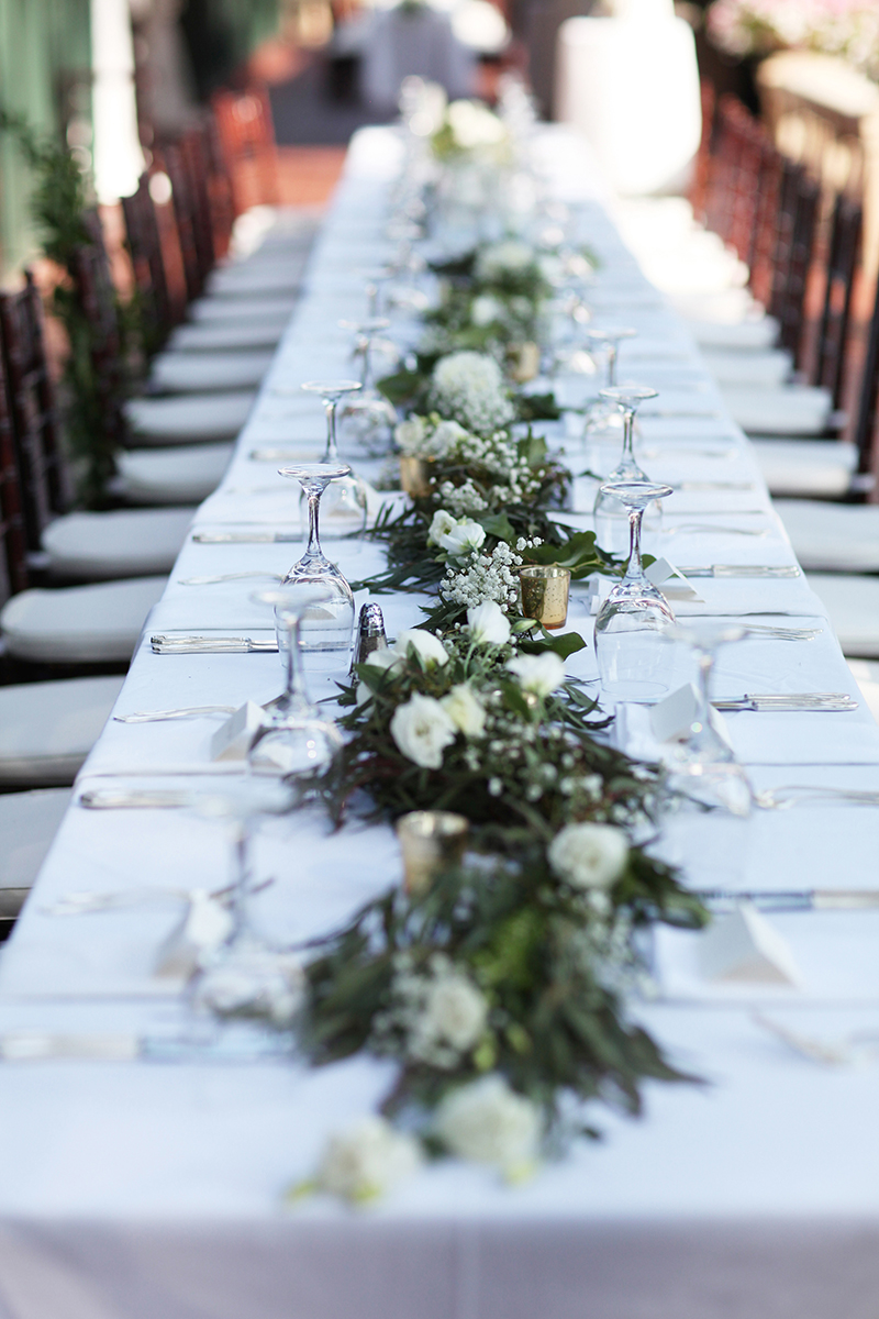 Greenery and White Florals on White Linen Dining Tables