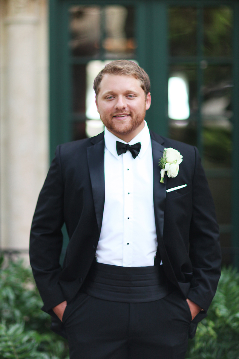 Groom in Classic Tuxedo and Traditional White Rose Boutonierre