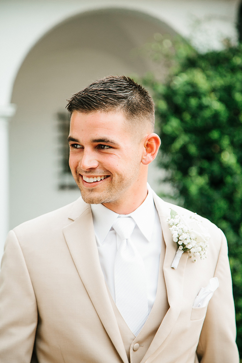 Groom in Tan Tuxedo with Baby's Breath Boutonierre