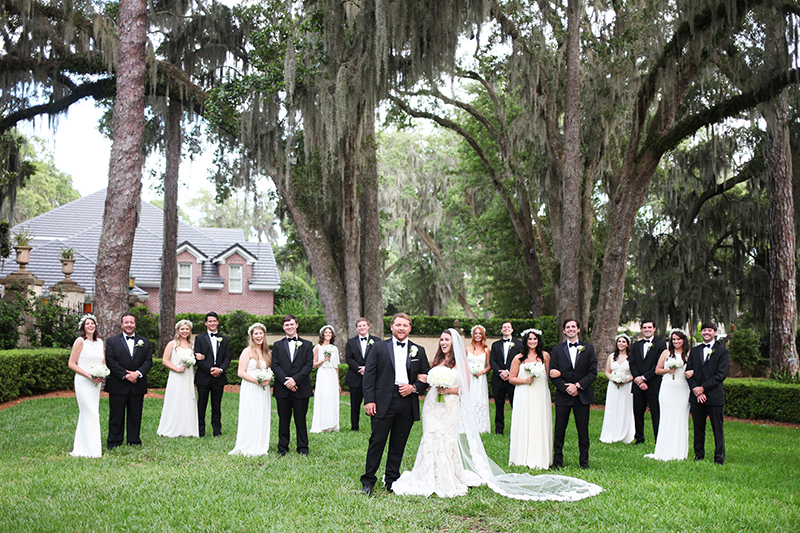 Groomsmen in Traditional Tuxedos and Bridesmaids in White Gowns