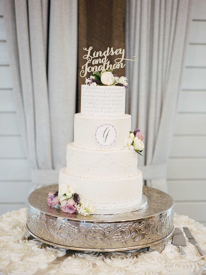 Ivory Wedding Cake with Lavender Accents and Custom Monogram