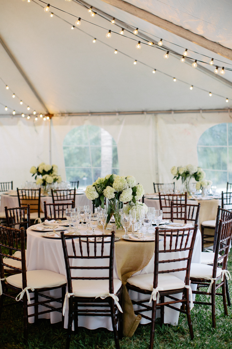 Ivory White Tent Wedding Reception Seating Display