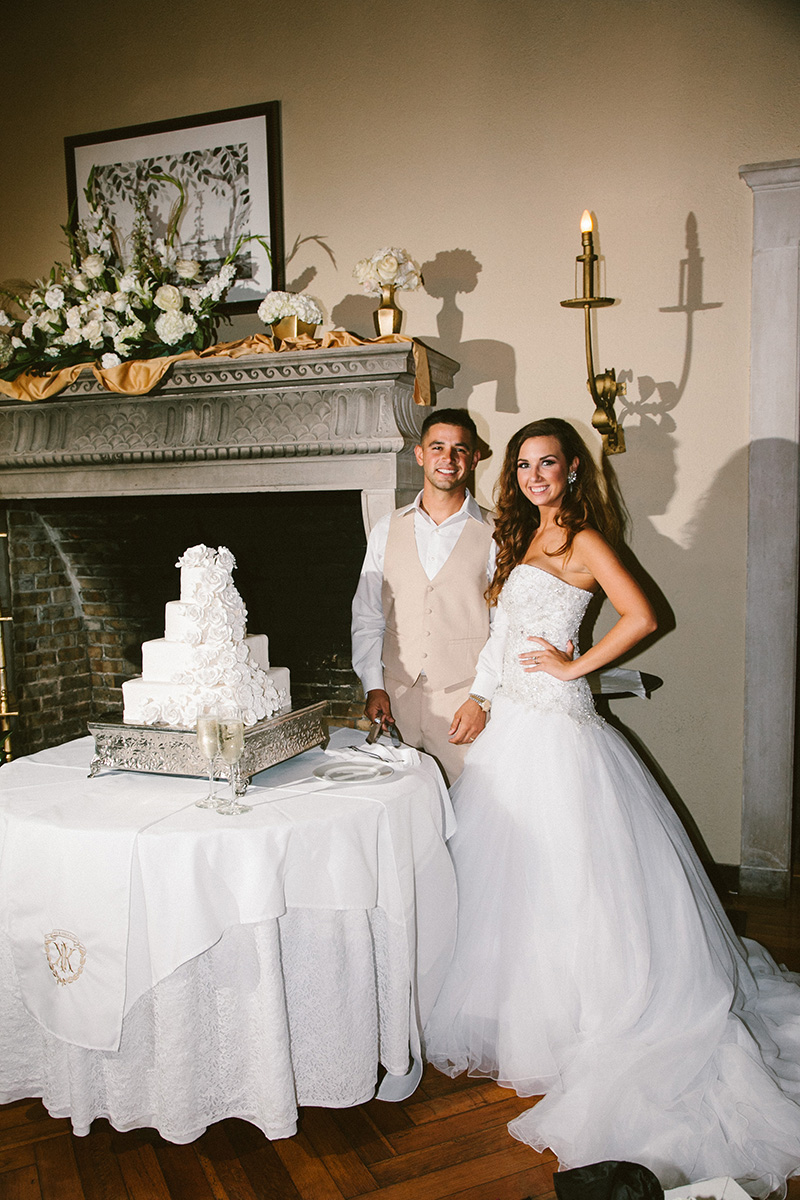 Jordan and Tyler Cutting Cake at The Jekyll Island Club in the Crane Cottage