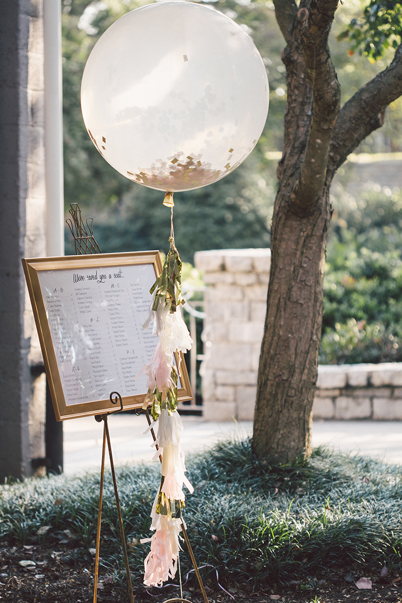 Large Balloon with Confetti and Tassel Garland with Seating Chart