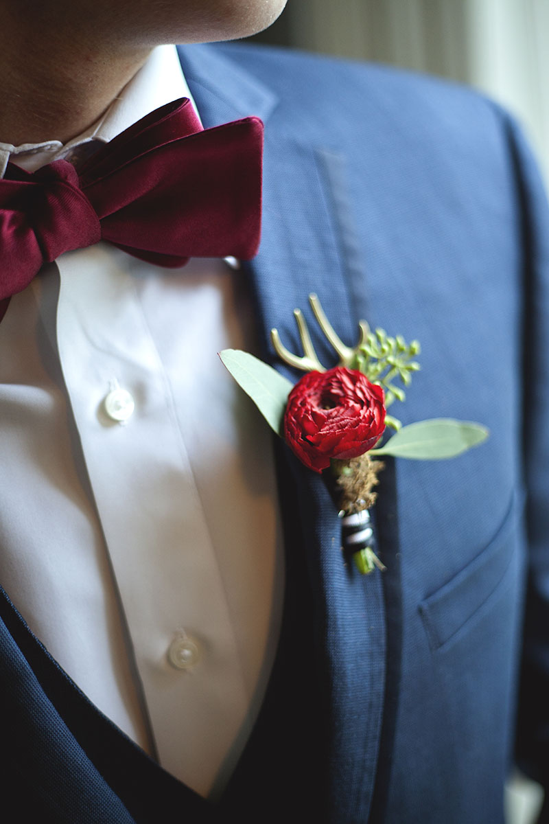 Red Ranunculus Boutonniere with Striped Ribbon, Seeded Eucalyptus and Antlers