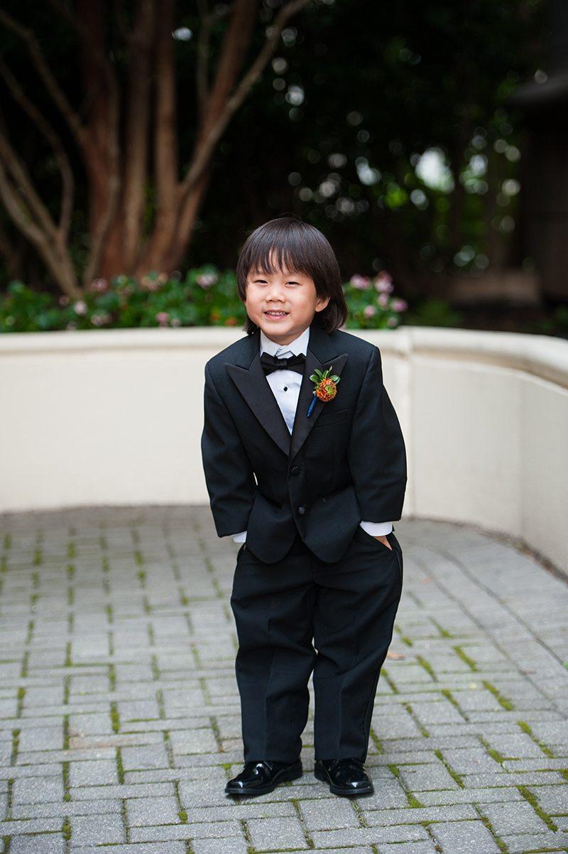 Ring bearer in black tuxedo