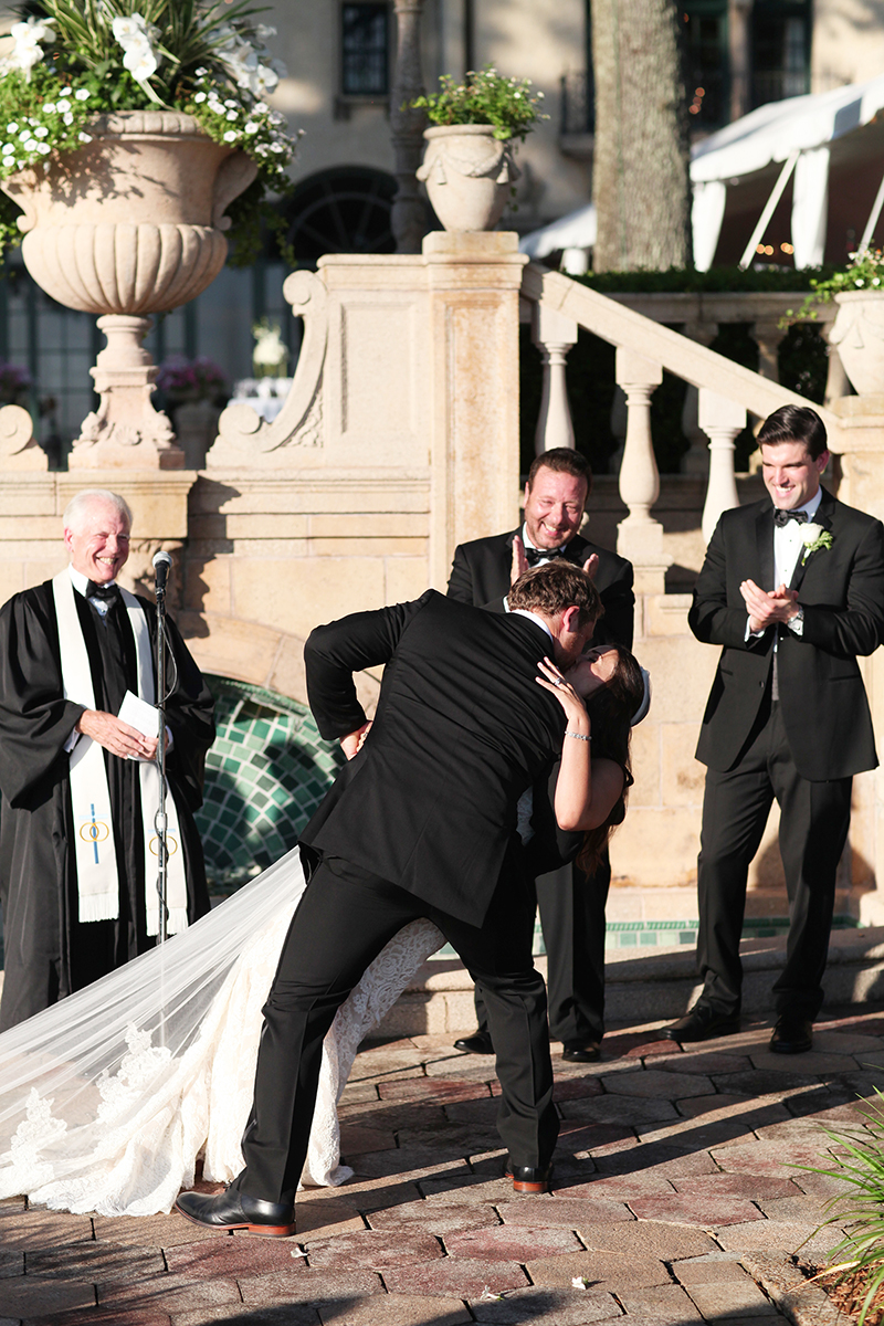 Swooping First Kiss at Wedding Ceremony