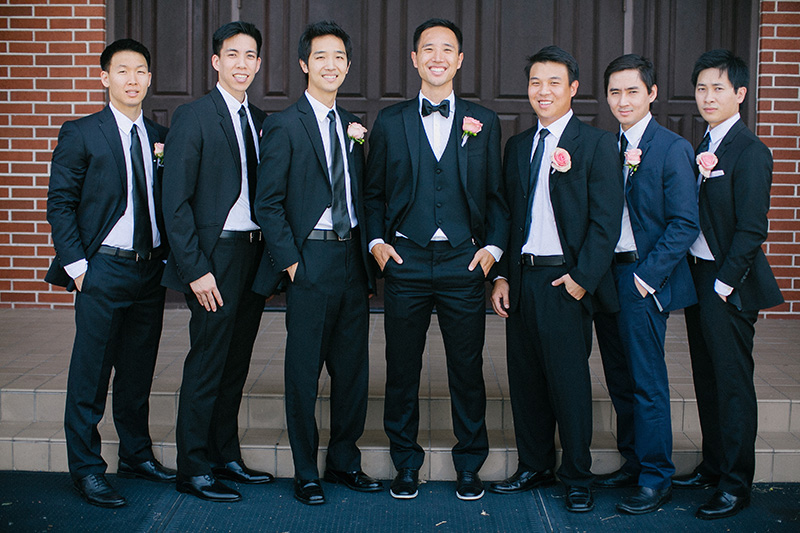 The groom with the groomsmen in dark blue suits