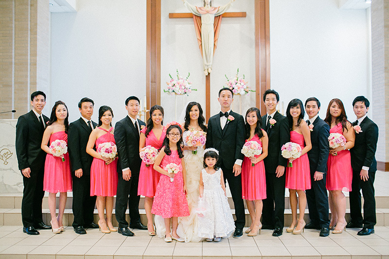 The wedding party with bridesmaids in hot pink dresses